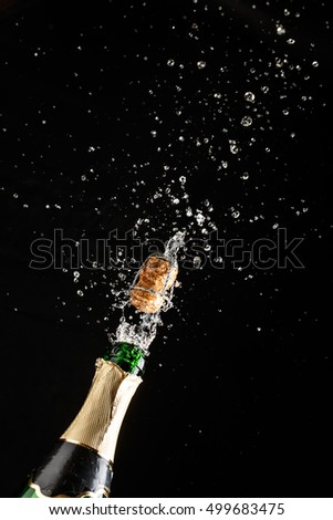 Champagne explosion and bright fountain of spray #499683475