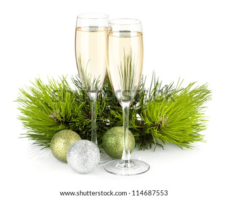 Champagne, fir tree and christmas decor. Isolated on white background - stock photo