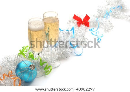 Champagne flutes and Christmas setting on white background