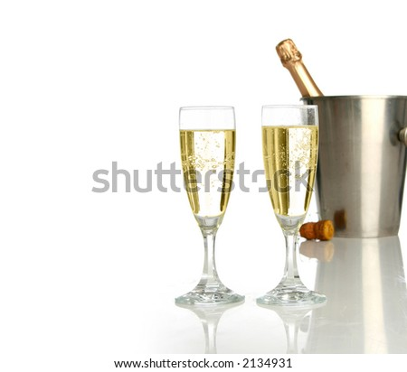 Champagne flutes and ice bucket, festive combo. - stock photo