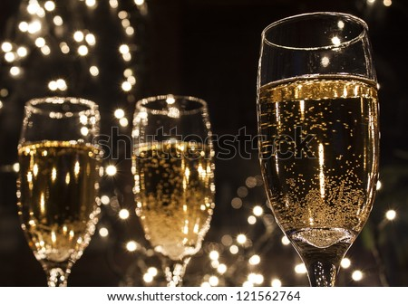 champagne flutes in holiday - stock photo