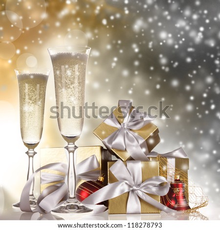 Champagne flutes with gold gifts
