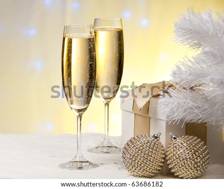 Champagne, gift box, snow and christmas toys.