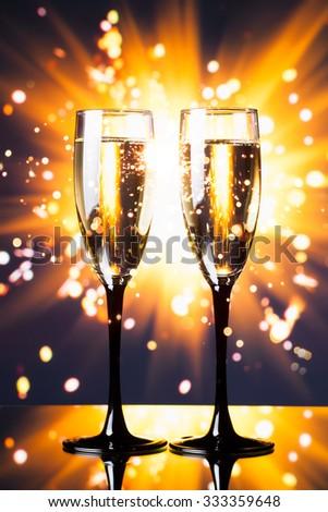 champagne glass against sparkler background #333359648