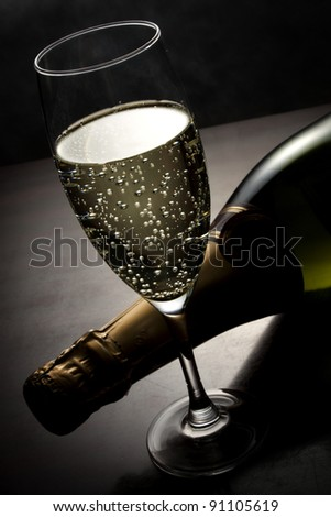 Champagne glass and bottle on the table