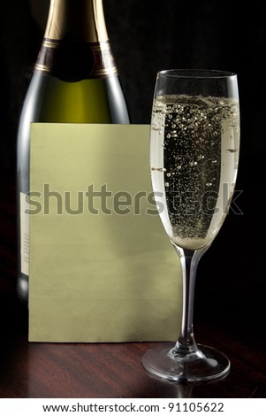 Champagne glass, bottle and wine list