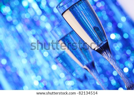 champagne glass on blue background