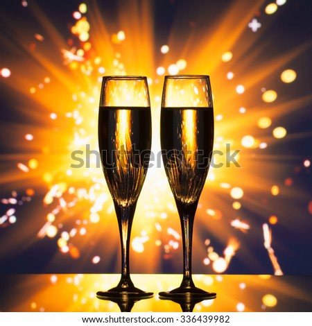 champagne glass silhouette against sparkler background #336439982
