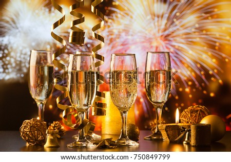 champagne glasses against holiday lights ready for New Year's eve party #750849799