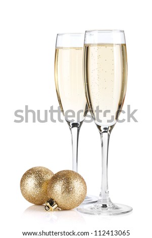 Champagne glasses and christmas baubles. Isolated on white background