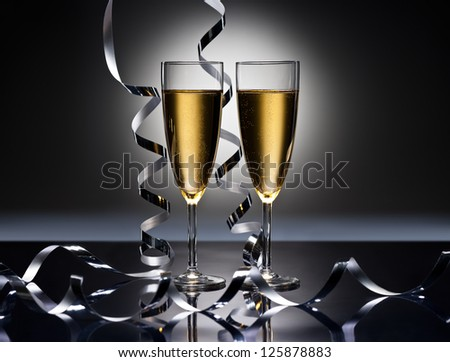 Champagne glasses in New Years party look