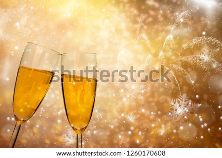 Champagne glasses on sparkling holiday background #1260170608