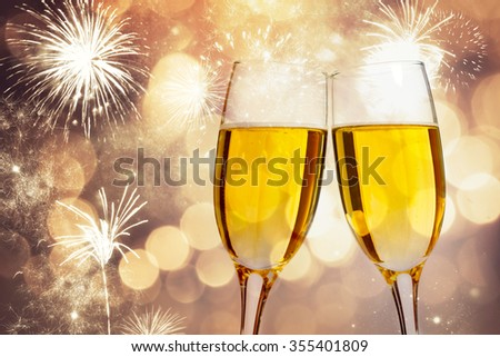 Champagne glasses on sparkling holiday background #355401809