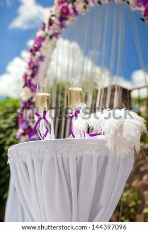 Champagne glasses on the background of the wedding arch