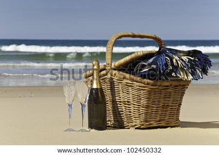 Champagne,glasses,picnic basket and blanket,perfect for a afternoon at the beach.