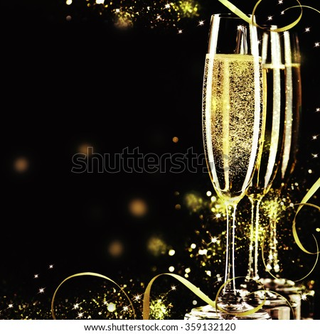 Champagne glasses ready to bring in the New Year.  - Shutterstock ID 359132120