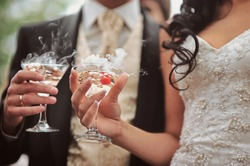 Champagne glasses. Wedding slide champagne for bride and groom. Colorful wedding glasses with champagne. Catering service. Catering bar for celebration. Beauty of bridal interior for wedding