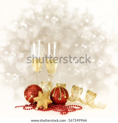 Champagne glasses with Christmas and New Year decorations in gold and red