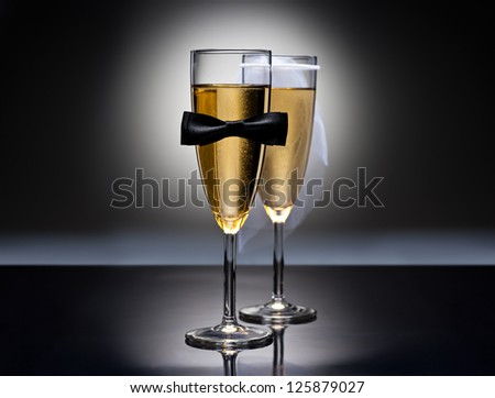 Champagne glasses with conceptual heterosexual decoration for straight couples