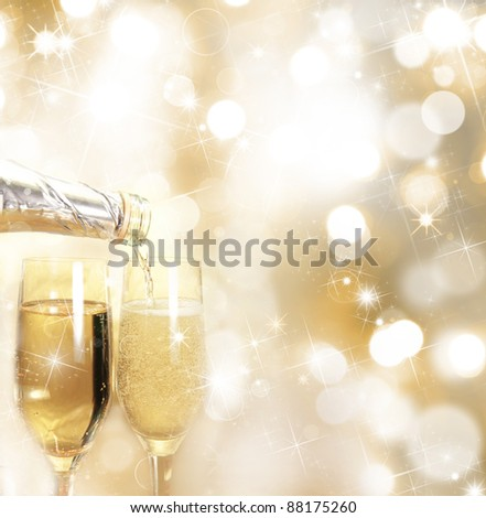 Champagne glasses with gold blurred background