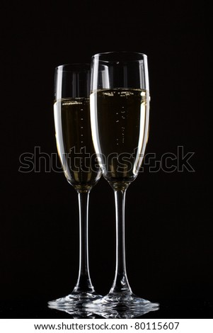 Champagne in glass isolated on a black background