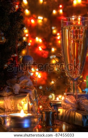 Champagne in glasses and twinkle lights on background.