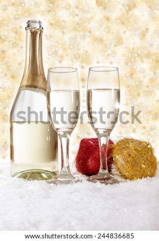 Champagne in glasses on golden background,new year concept