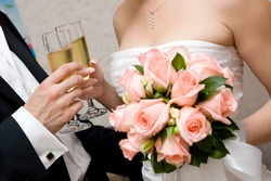 champagne in hands of bride and groom