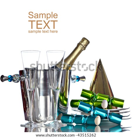 Champagne In Silver Bucket With White Plates, Gold Party Hat, and Green And Blue Party Favors