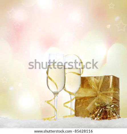 Champagne in two glasses with present and Christmas decoration on  the Christmas background