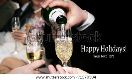 Champagne is being poured to the glasses at black background. Represents party. Free space for your text and can be used as template for web design and magazine