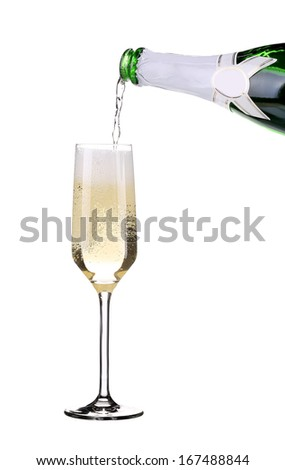 Champagne pouring in a glass. Isolated on a white background.