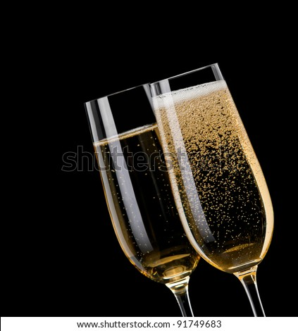 Champagne pouring in to a glass on a black background
