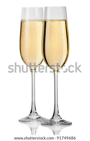 Champagne pouring in to a glass on a white background