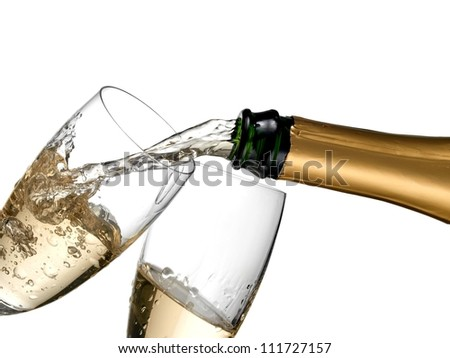 Champagne pouring in two glasses