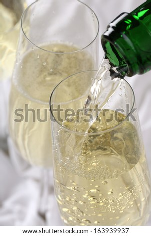 Champagne pouring into a glass on birthday or New Year's Eve