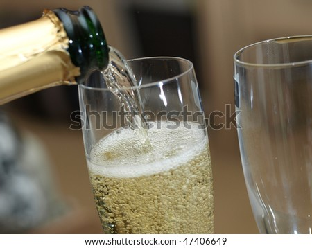 Champagne pouring into the glass