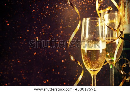 Champagne ready to bring in the New Year - Shutterstock ID 458017591