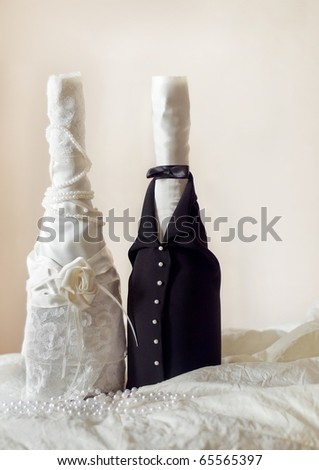 stock photo Champagne wedding bottles in suit