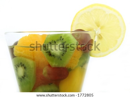 Champagne wine and fruit in a glass with lemon lime, macro close up isolated on white, with copy space