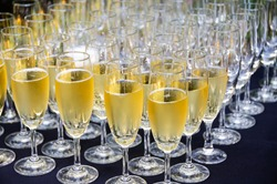 Champagne wine in glasses ready for toasting at wedding reception