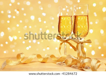 Champagne with blur light, in golden tone, suited for Christmas or New year concept