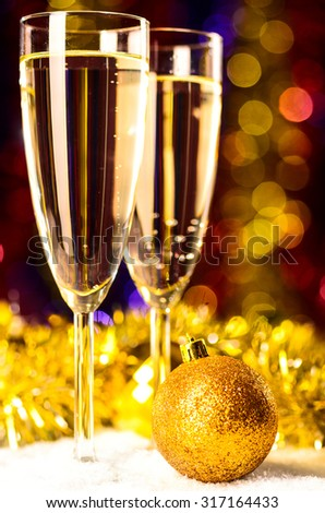 champagne with christmas toys on blurred background #317164433