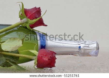 Champagne with flowers - stock photo