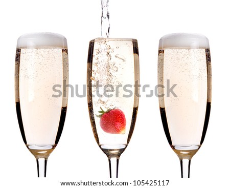 Champagne with strawberry - christmas alcohol cocktail. Isolated on white background