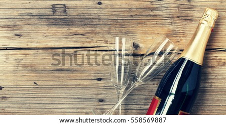 Champagne. Women's Day, 8 March. Champagne bottle and two empty glasses on a wooden background. Valentine's Day. Birthday. Wedding. Anniversary. Rustic style.