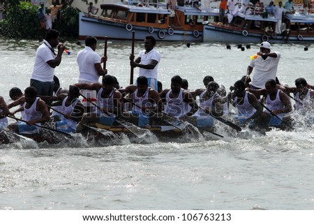 CHAMPAKKULAM, INDIA - JUL 03 : A team participate in the Snake boat racing at the banks of Pumba river on July 03, 2012 at Champakkulam, Kerala, India.