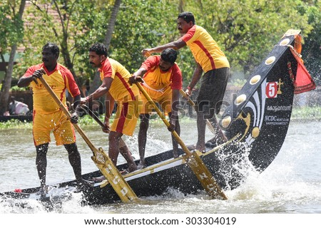 CHAMPAKULAM, INDIA - JULY 01: largest team sport, men wearing traditional dress participate at the Champakulam vallam kali (snake boat race) on July 01, 2015 in Alappuzha, Kerala, India. Festival Onam