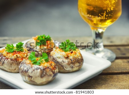 Champignon mushrooms filled with cheese and spices  (shallow dof)
