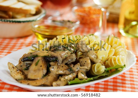 Champignon mushrooms in cream sauce with pasta